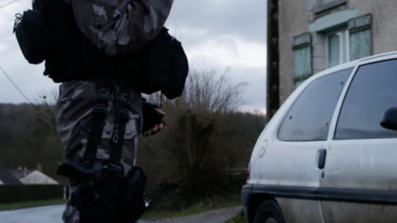 French police expand search for killers