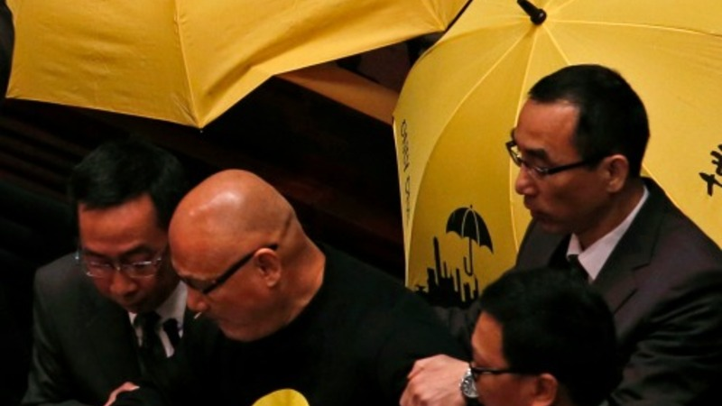 Hong Kong protesters crash government speech