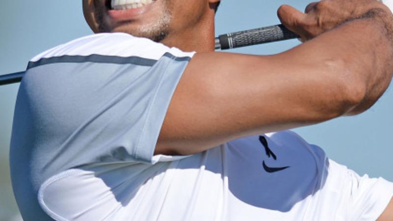 Tiger Woods steps back from pro golf
