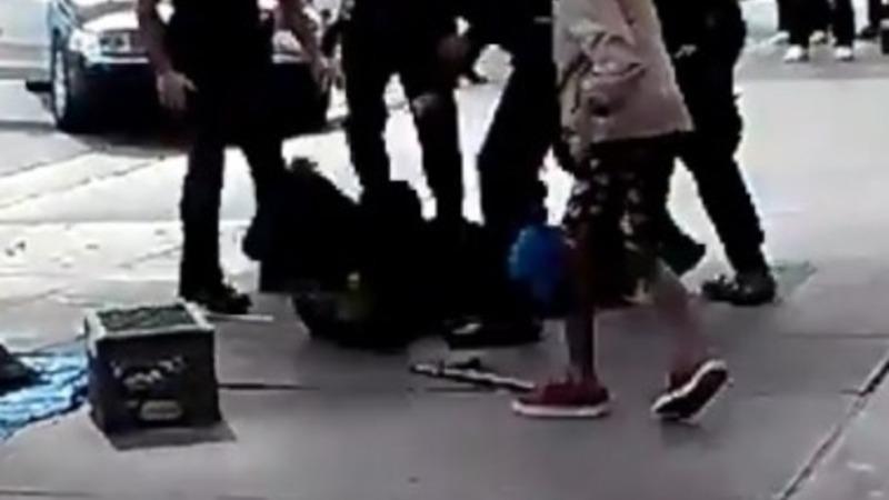 LAPD say homeless man shot went for cop's gun