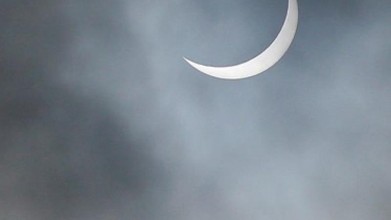 Solar eclipse casts UK into shadows