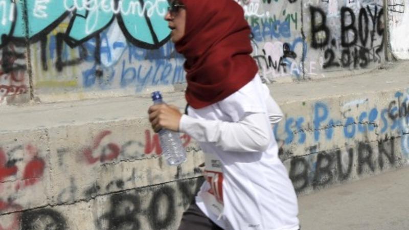 West Bank marathoners run in protest
