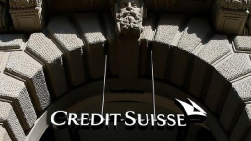 Credit Suisse hit despite profit rise