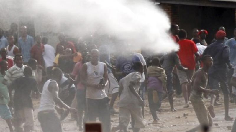 Burundi police confront protesters