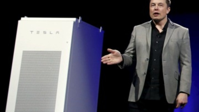 Tesla aims batteries beyond cars, into homes