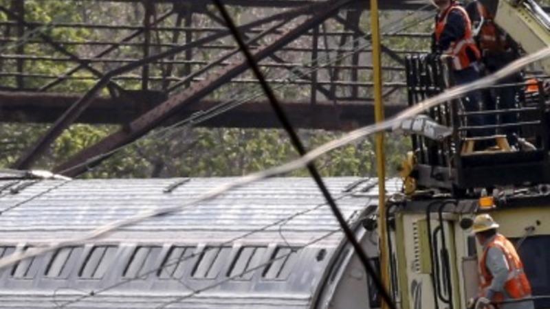 VERBATIM: Investigators sweep train crash site