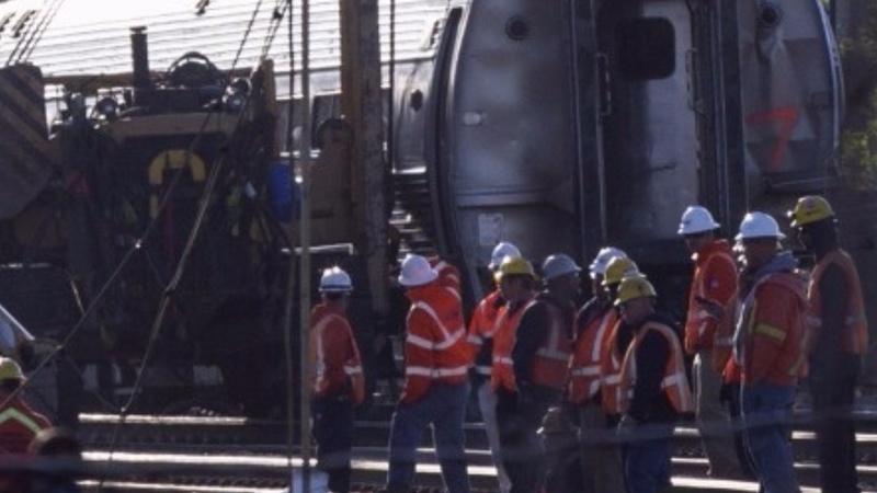 Eighth person found dead in Amtrak derailment
