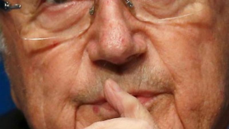 Blatter keeps low profile as pressure mounts