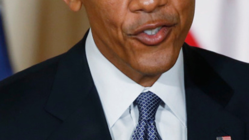 Obama defends health law as ruling looms
