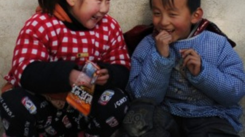 "China struggles with kids ""left behind"""