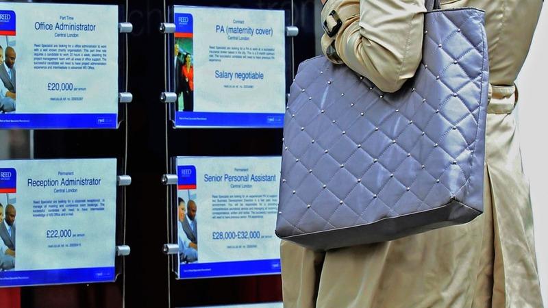 UK unemployment falls, wages rise