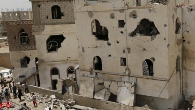 Sanaa residents assess air strikes damage