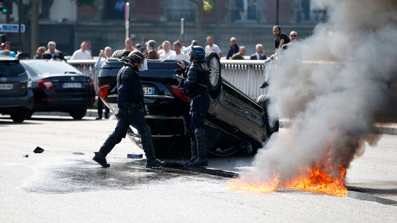 France orders UberPOP ban after violent protests