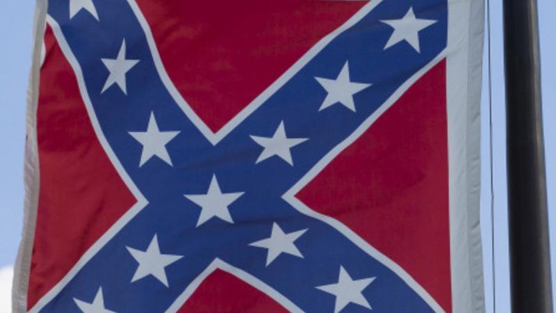Activist takes down Confederate flag in SC