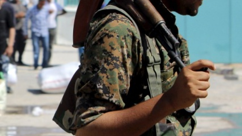Syrian Kurds reclaim border town from IS