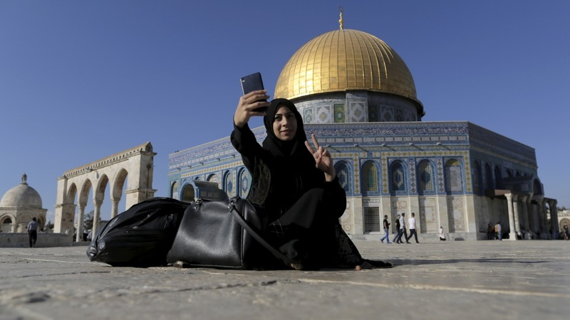 Palestinians embracing selfies at holy site