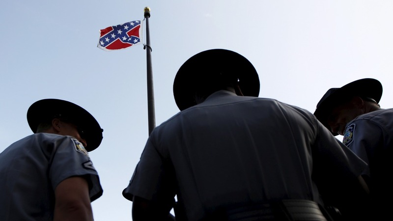 The Confederate banner comes down