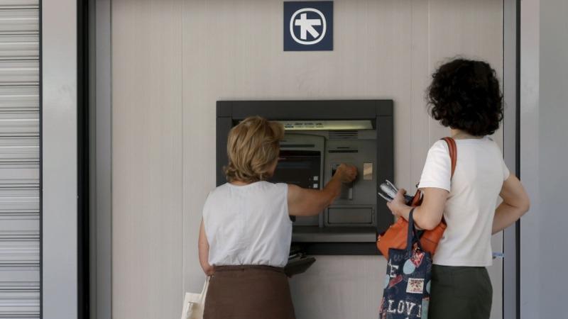 Greek banks kept on 'tight leash' lifeline