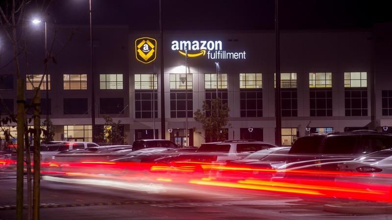 Amazon surprises with rare quarterly profit