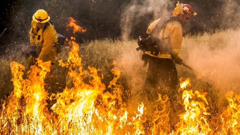 Wildfires blaze through California