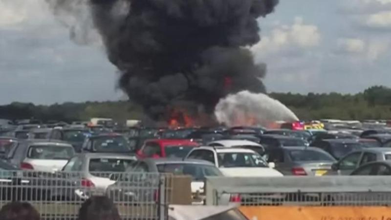 Plane crashes into UK car auction site