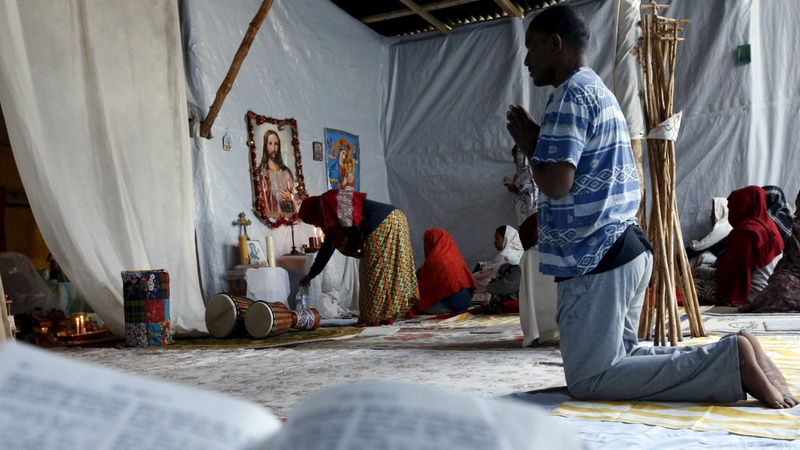 Sunday mass brings brief respite in Calais