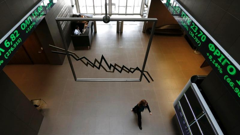 Greek stocks mauled as market reopens