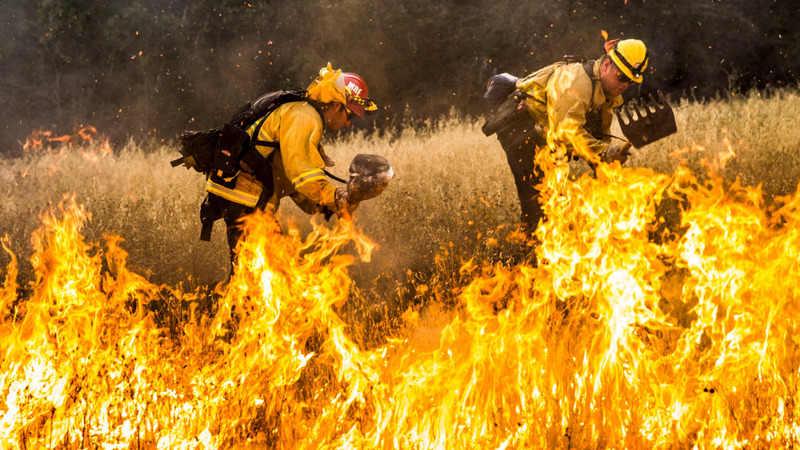 California wildfires rage, draining resources