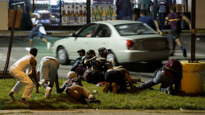 Police shoot gunman at Ferguson protest
