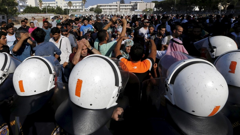 Migrants and police clash on Greek island