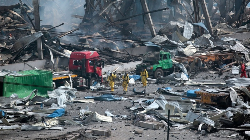 China searches for cause of huge twin blasts