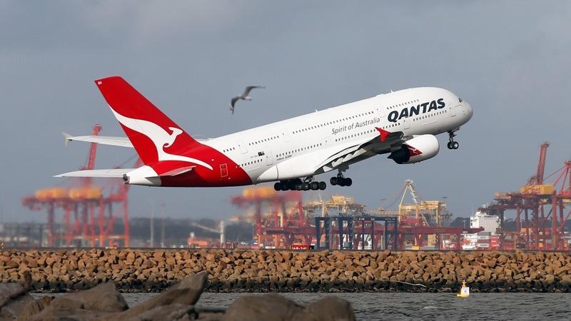 Qantas flies back into the black
