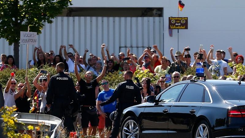 Merkel condems attacks on refugee housing