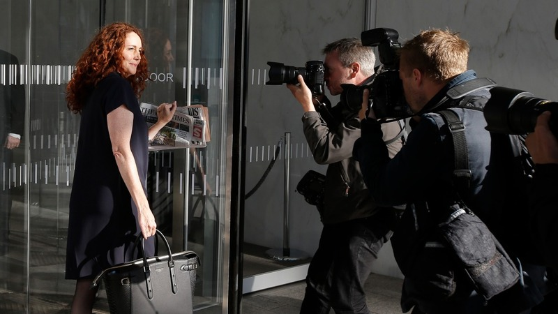 Rebekah Brooks faces paps as she returns to work
