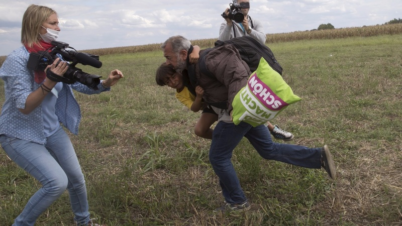 Hungarian camerawoman kicks fleeing migrants
