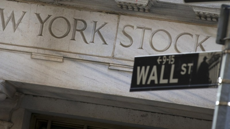 Justice Dept. cracks down on Wall Street execs