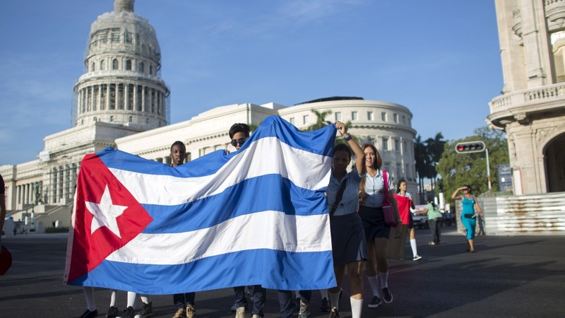Obama relaxes rules on business with Cuba