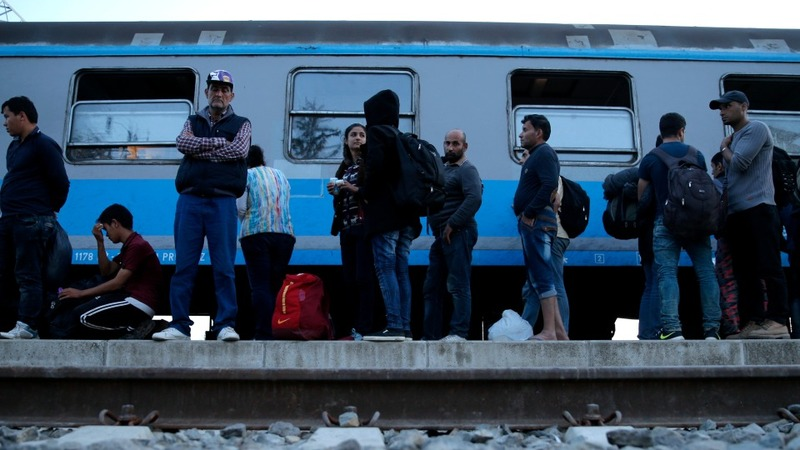 EU ministers back refugee-sharing plan