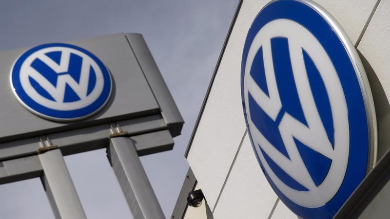 Merkel defends car industry after VW scandal
