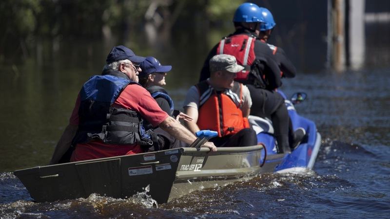 Heroic flood rescue, but more rain to come