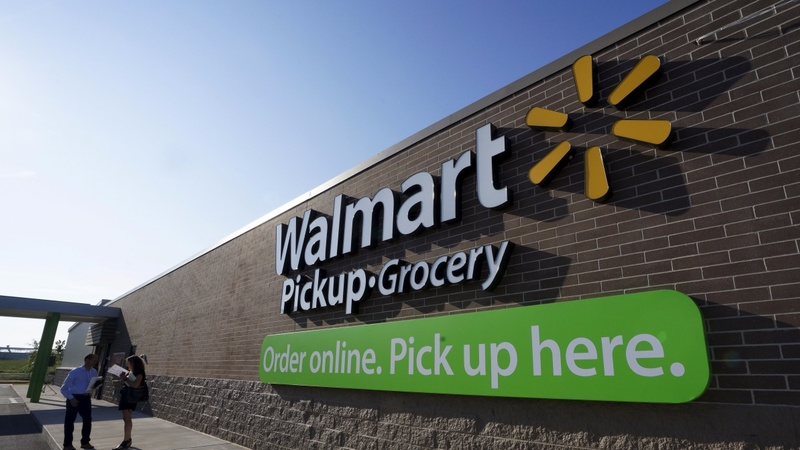 Wal-Mart shares sink on sales forecast