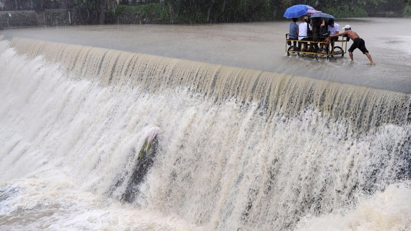 Slow-moving typhoon lingers in Philippines