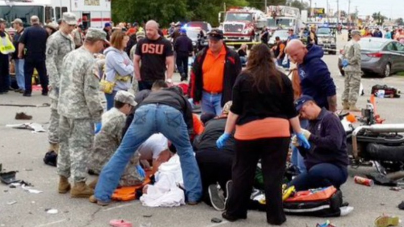 Three dead after car plows into parade