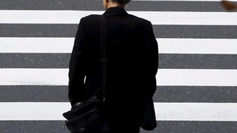 Japan slides back into recession