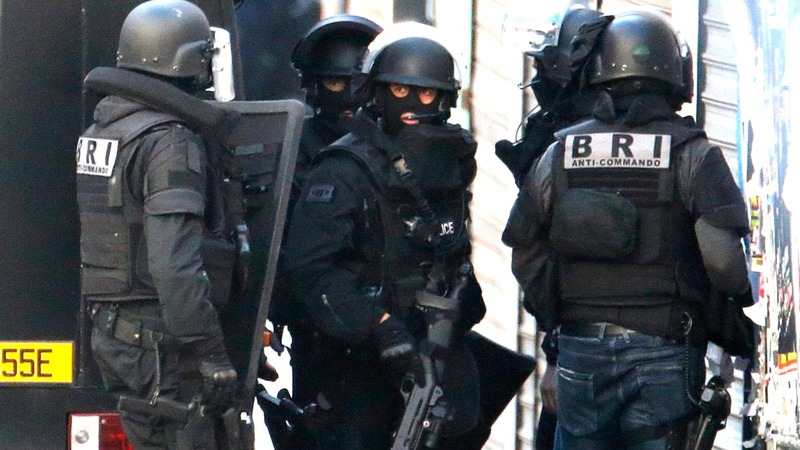 Two die and eight arrested in Paris police raid