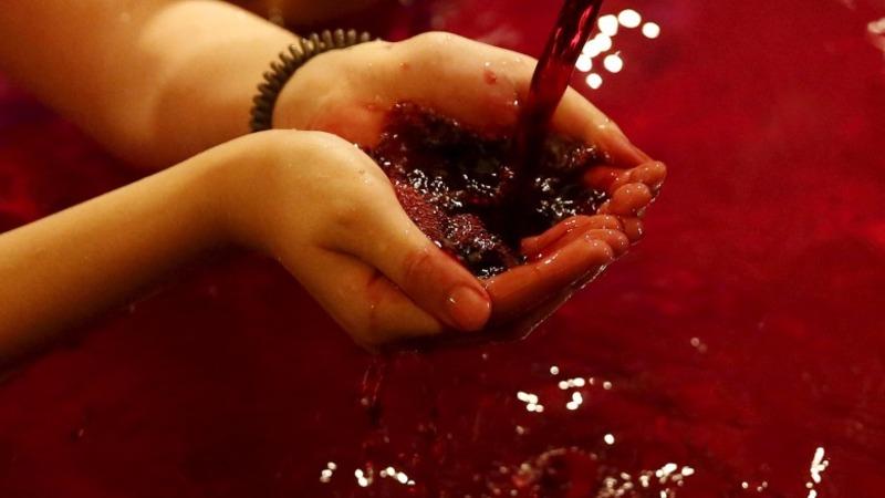 Japanese bathe in Beaujolais Nouveau wine