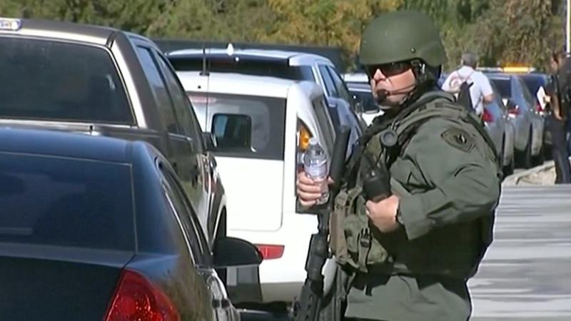 Police hunt armed suspects in San Bernardino shooting