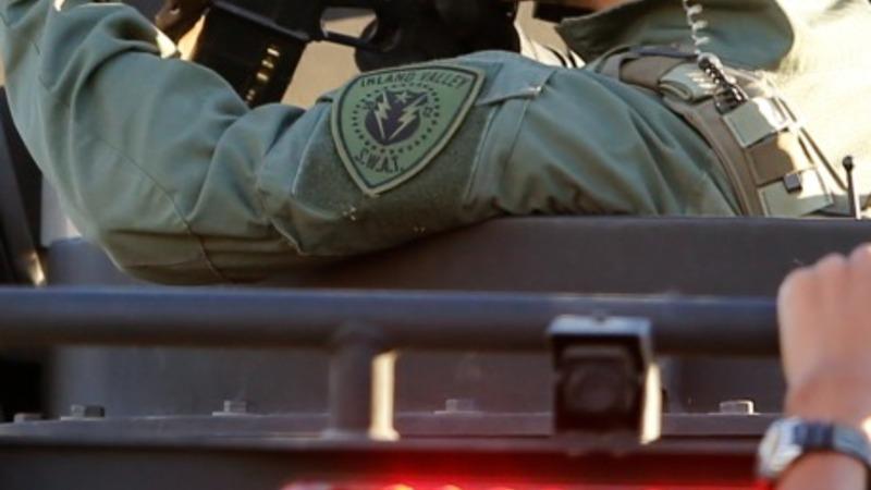 Massacre revives debate over gap in gun laws