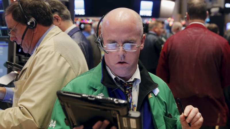 Wall Street slides as oil prices fall