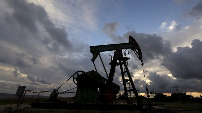 Oil hits a 2004 low but Wall Street rallies